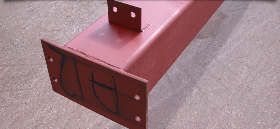 Red steel beam with writing