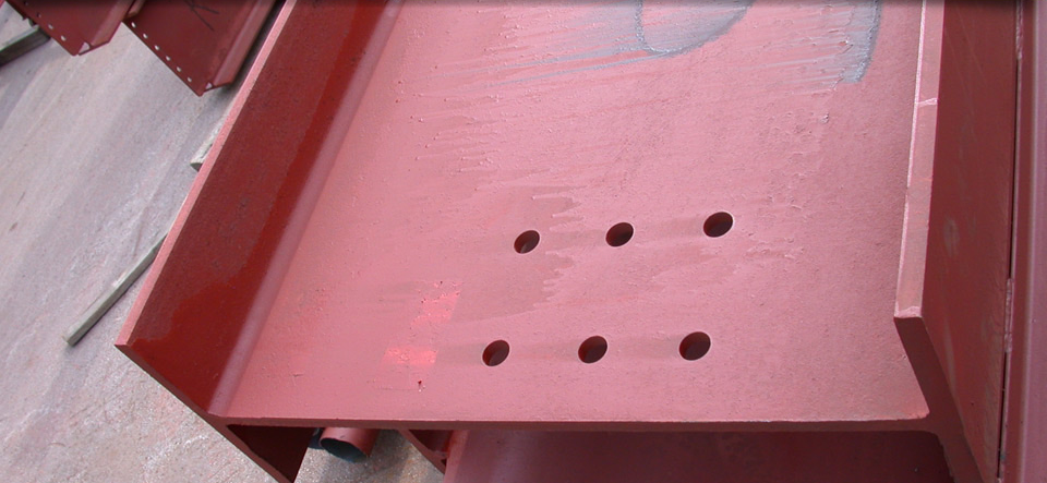 Red I-beam with holes